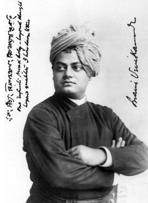 Black and white image of an Indian man standing